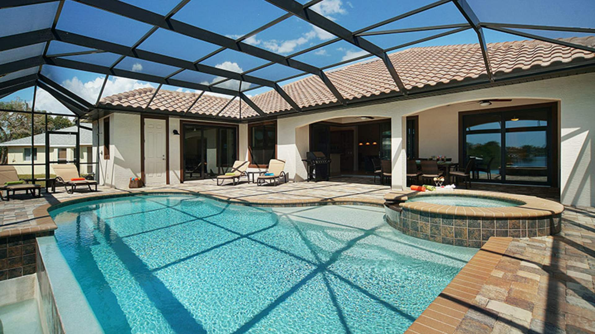 The large pool area includes a covered patio and sundeck, pool and spa