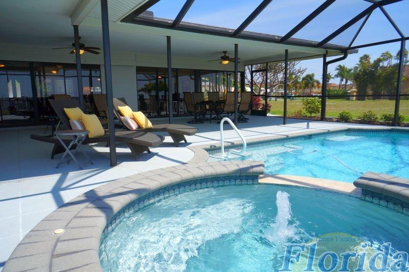 The large pool area includes an electrically heated pool with spa