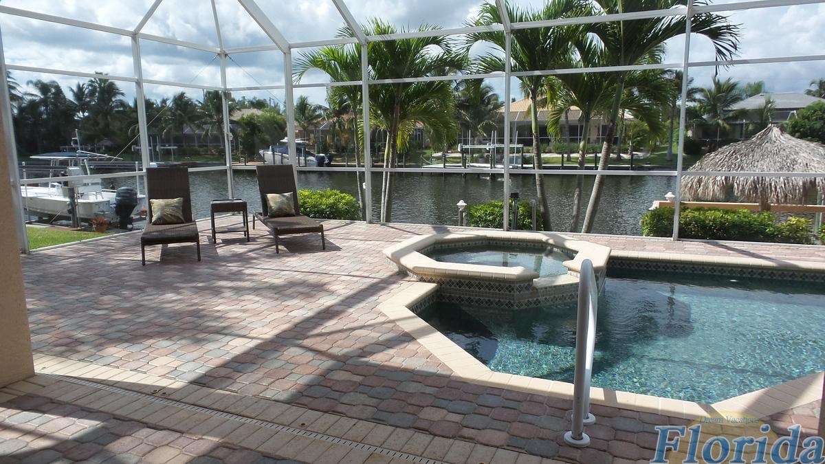The beautiful paved pool area includes an electrically heated pool with spa