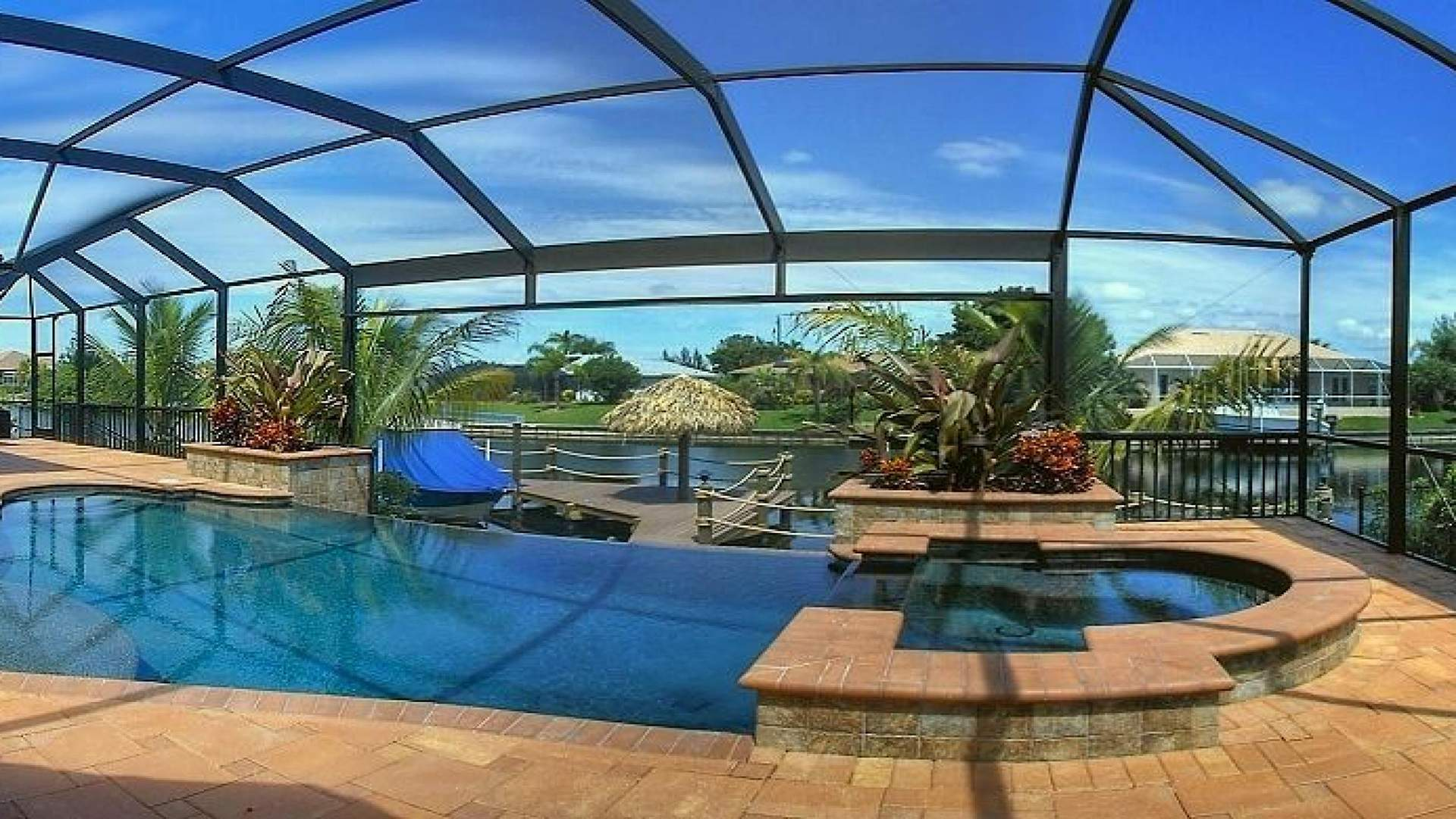 superior terrace with electric heated pool and spa and a great view over the water