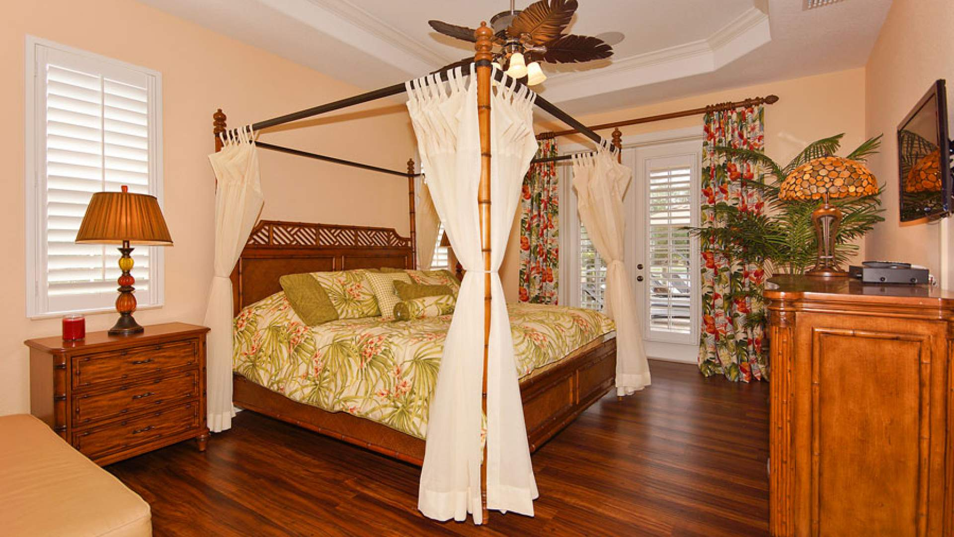 The master bedroom is dominated by tropical accents