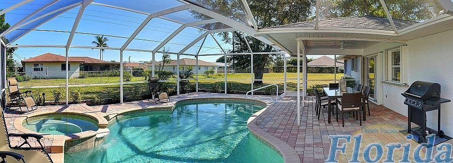 The beautifully designed pool area includes a covered patio