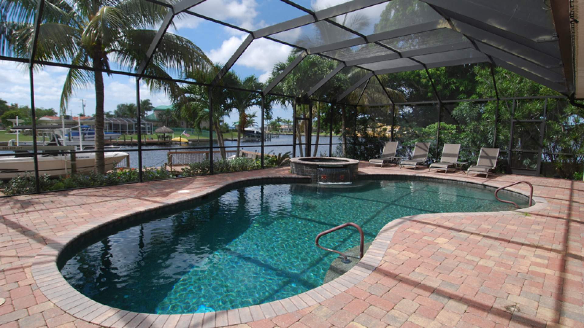The large pool area overlooks the wide sailboat canal