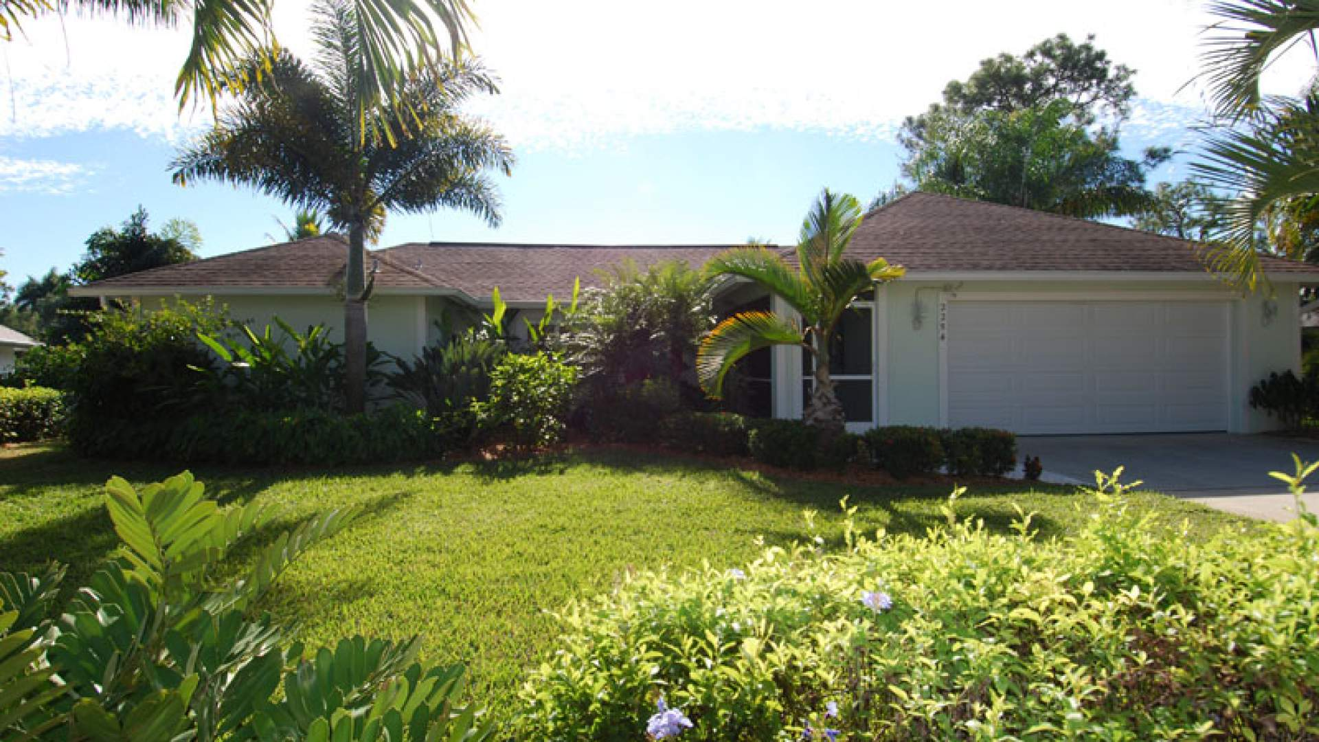 This inviting vacation home is located in the Kings Lake community in Naples
