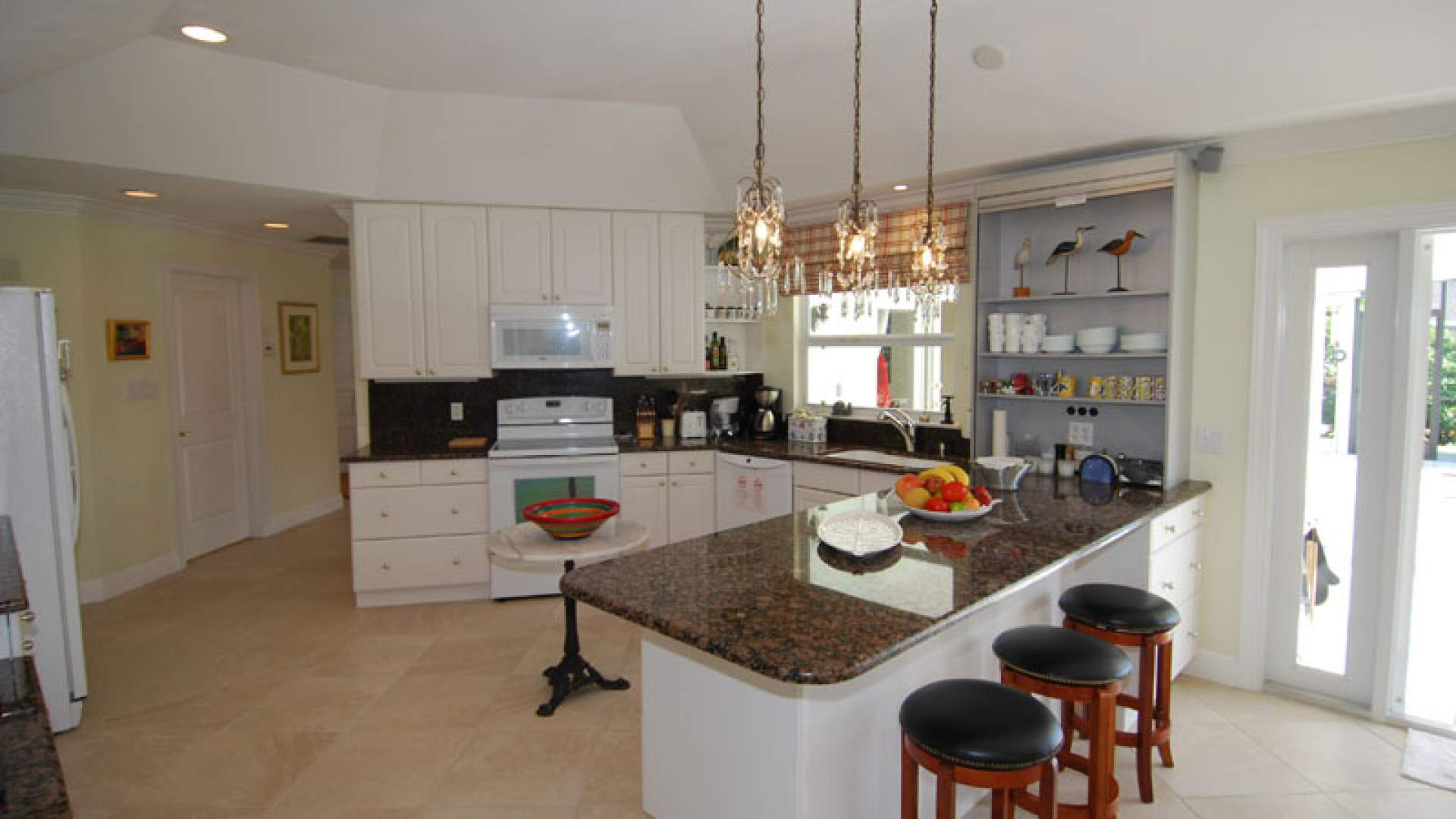 The spacious open kitchen comes fully equipped