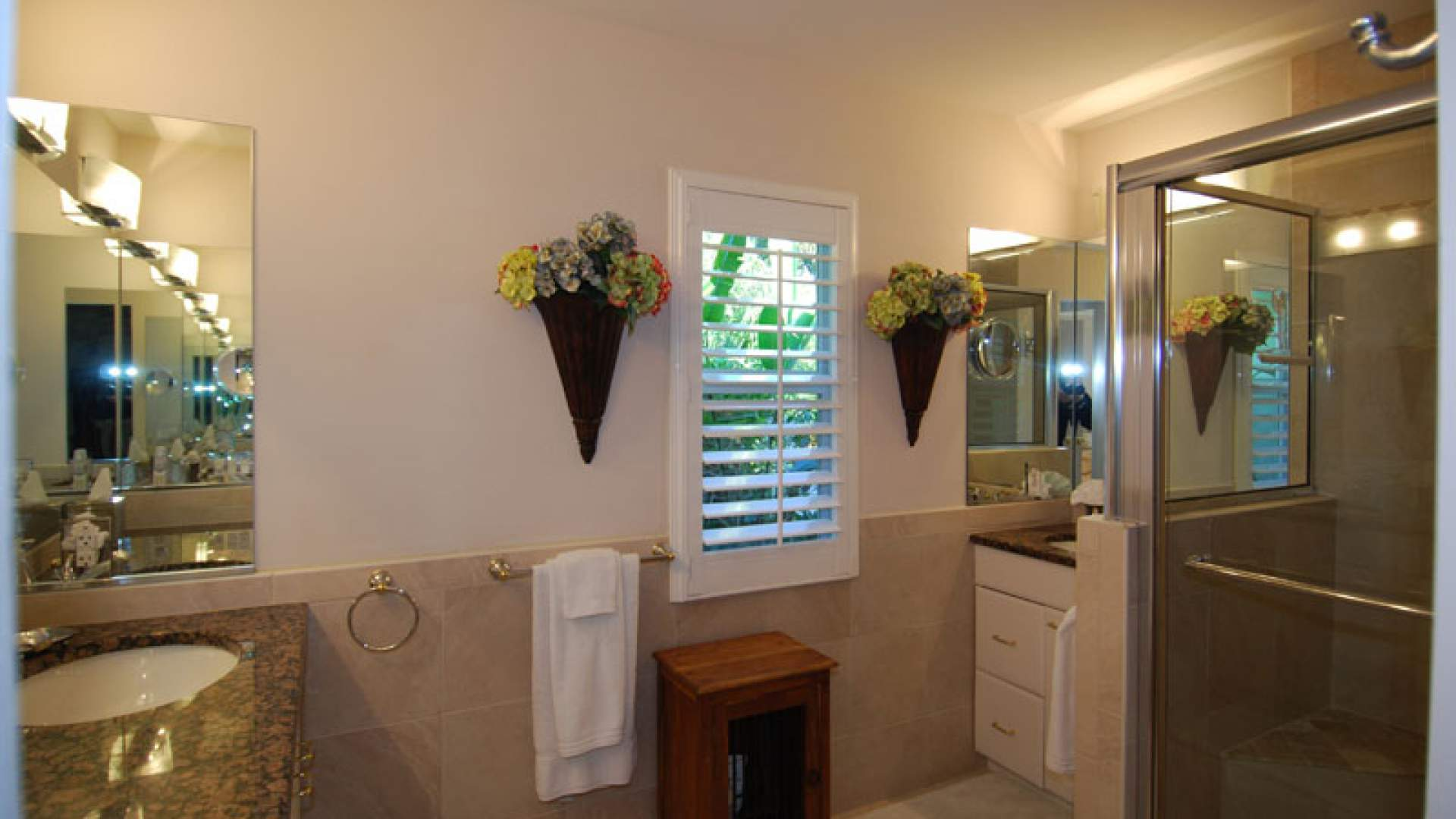 The elegant master bath includes a shower and double sinks