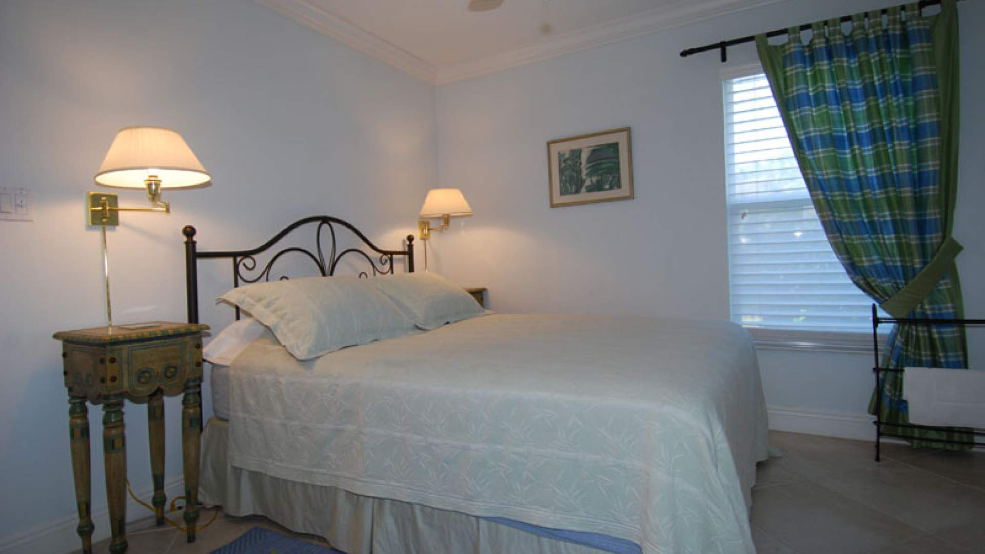 The inviting third bedroom offers a Queen size bed