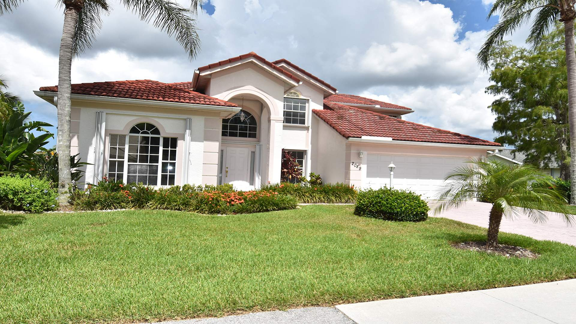 This attractive two-story home is located in the Crown Pointe community in Naples