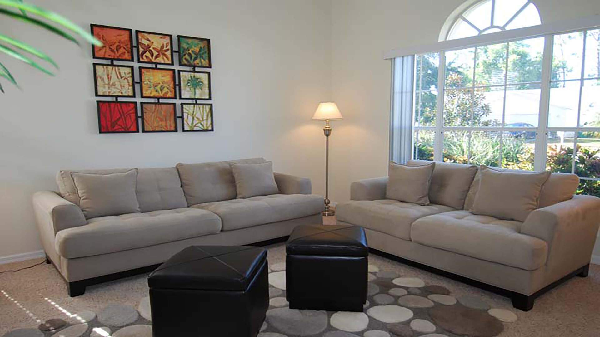 living area withtwo sofas by the entrance area