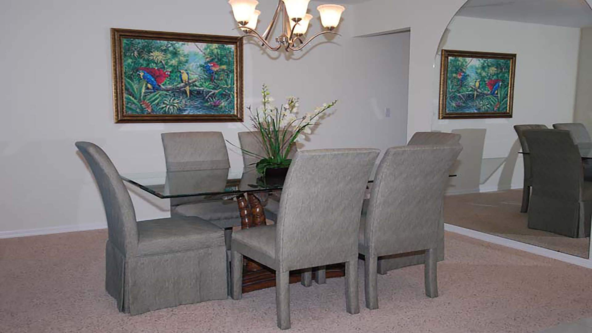 Dinning Area with 6 gray chairs