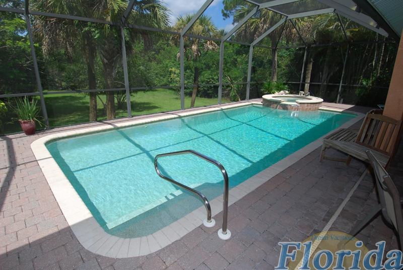 Pool and spa can be electrically heated and overlook the expansive backyard